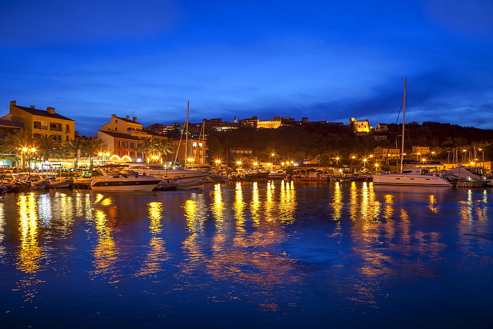 Harbour lit up at dusk, Porto Vecchio, Corsica, France, Mediterranean, Europe