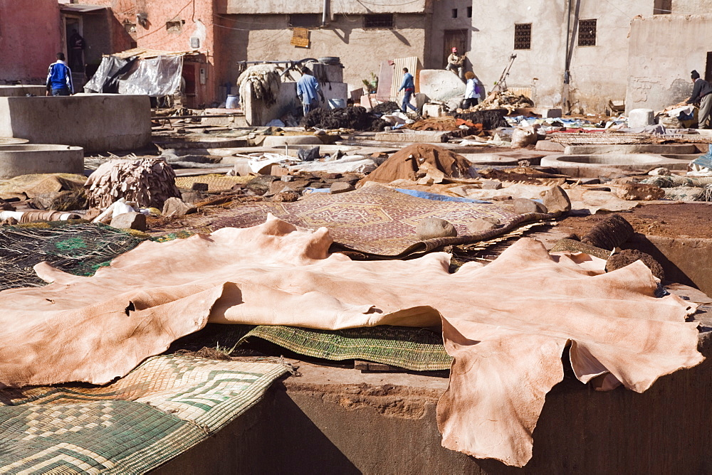 Vats and leather hides in an old Tannery owned by cooperative of families in the Medina, Marrakech, Morocco, North Africa, Africa - 586-1497