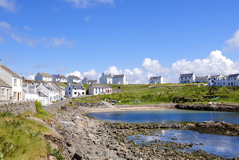 Cottages around harbour in village of Portnahaven, Isle of Islay, Argyll and Bute, Inner Hebrides, Scotland, United Kingdom, Europe