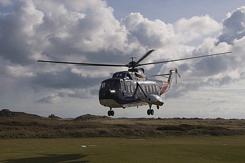 Helicopter landing at Tresco, Isles of Scilly, United Kingdom, Europe