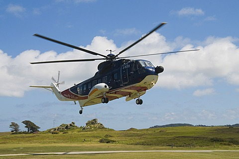 Helicopter landing at Heliport, Tresco, Isles of Scilly, Cornwall, United Kingdom, Europe