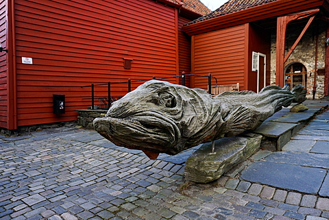Carved wooden statue of a stock fish a type of cod, Hanseatic quarter, Bryggen, Bergen, Hordaland, Norway, Scandinavia, Europe