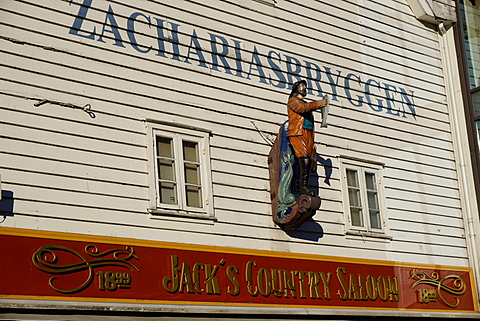 Statue of man holding fish, Bryggen, Bergen, Hordaland, Norway, Scandinavia, Europe