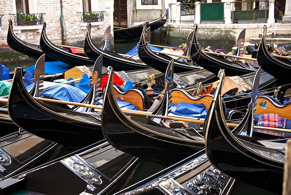 Gondolas parking on a canal, Venice, UNESCO World Heritage Site, Veneto, Italy, Europe
