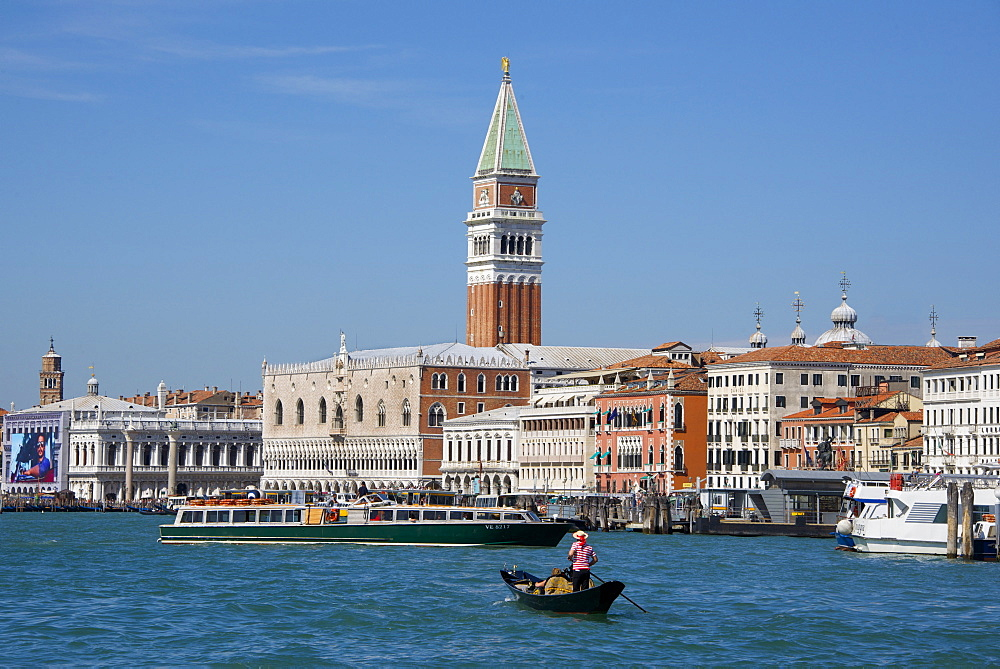 Gondola and gondolier on San Marco Basin, with Palazzo Ducale, San Marco Campanile, and Danieli Hotel in the background, Venice, UNESCO World Heritage Site, Veneto, Italy, Europe - 665-5476