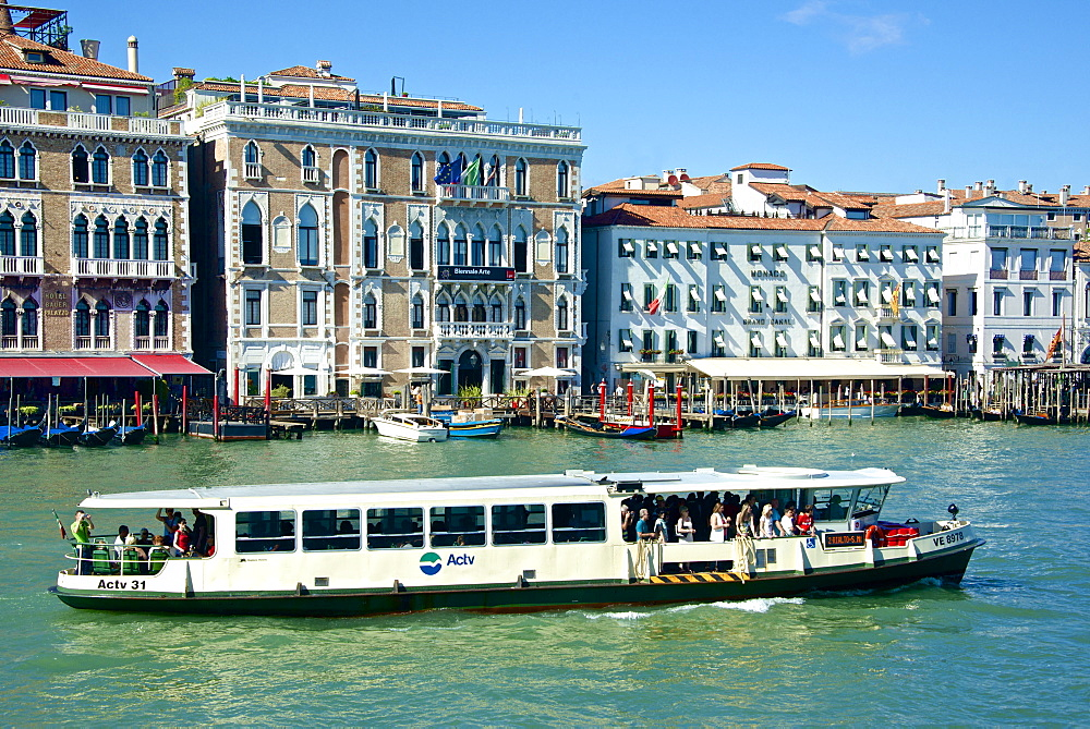 Vaporetto, Hotel Bauer, Hotel Monaco, palace facades and gondolas on the Grand Canal, Venice, UNESCO World Heritage Site, Veneto, Italy, Europe