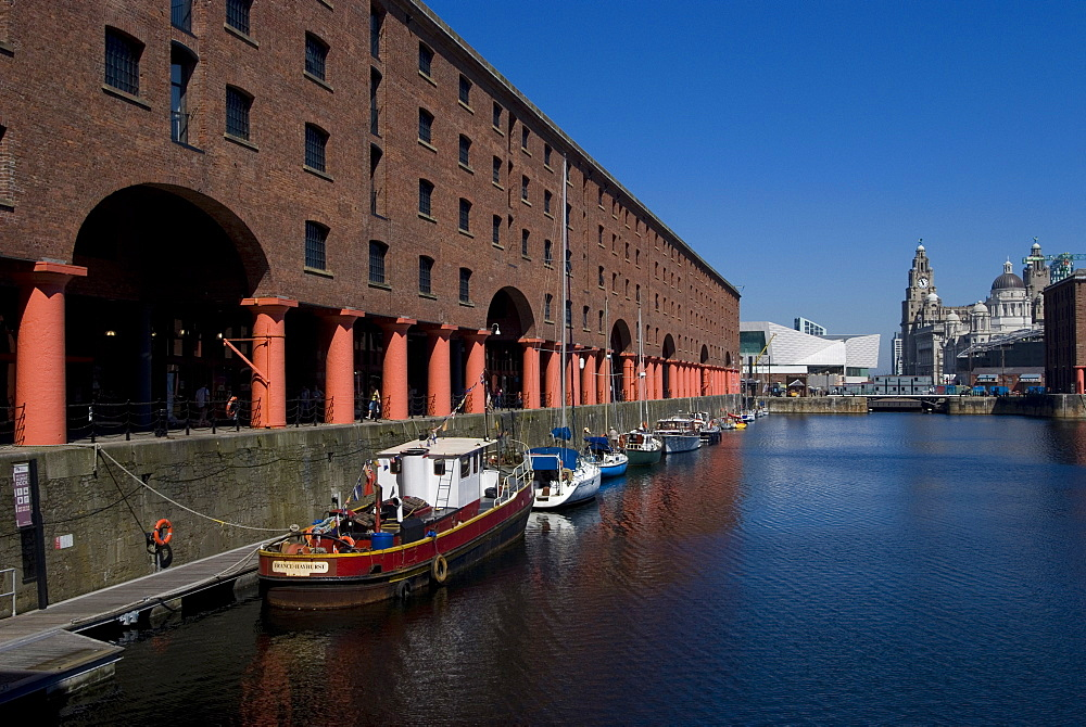 Albert Dock with view of the Three Graces on the riverfront, UNESCO World Heritage Site, and new Museum of Liverpool in the background,  Liverpool, Merseyside, England, United Kingdom, Europe