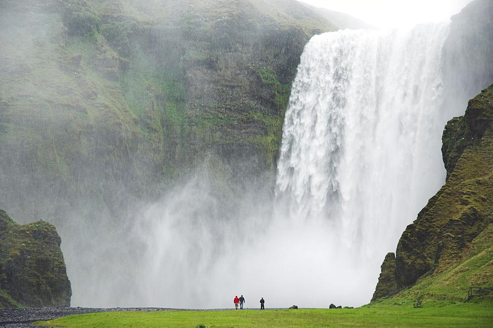 Tourists at Skogafoss waterfall, Skogar, South area, Iceland, Polar Regions