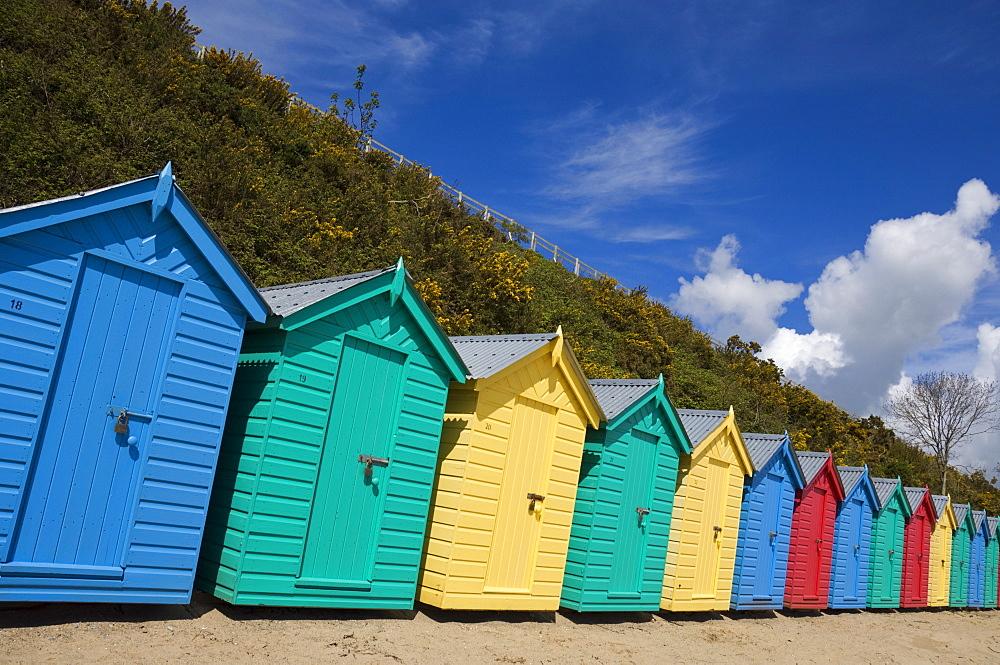 Multicoloured beach huts on the long sweeping beach of Llanbedrog, Llyn Peninsula, Gwynedd, North Wales, Wales, United Kingdom, Europe