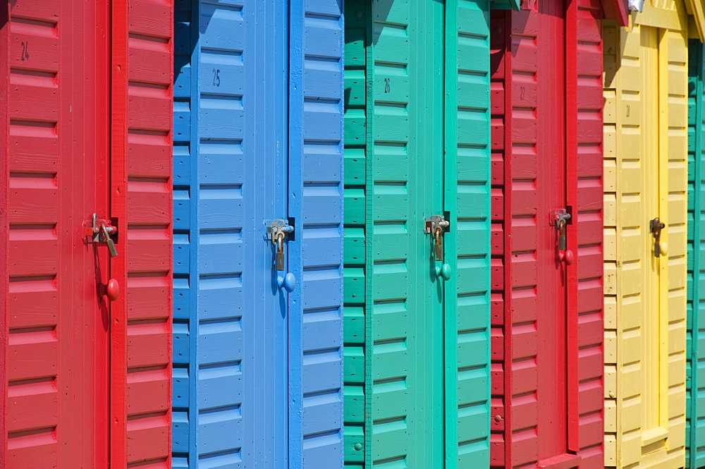 Close-up of multicoloured beach huts on the long sweeping beach of Llanbedrog, Llyn Peninsula, Gwynedd, North Wales, Wales, United Kingdom, Europe