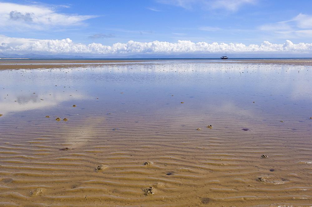 Reflections in the tidal seawater pools of the long sweeping beach of Llanbedrog, Llyn Peninsula, Gwynedd, North Wales, Wales, United Kingdom, Europe