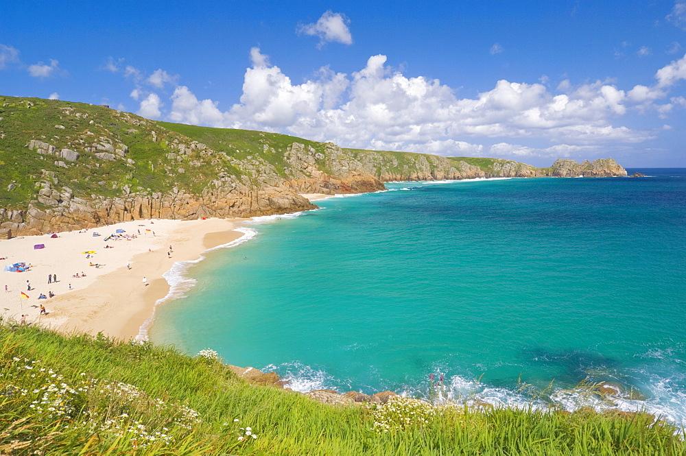 Holidaymakers and tourists sunbathing on Porthcurno beach, Cornwall, England, United Kingdom, Europe