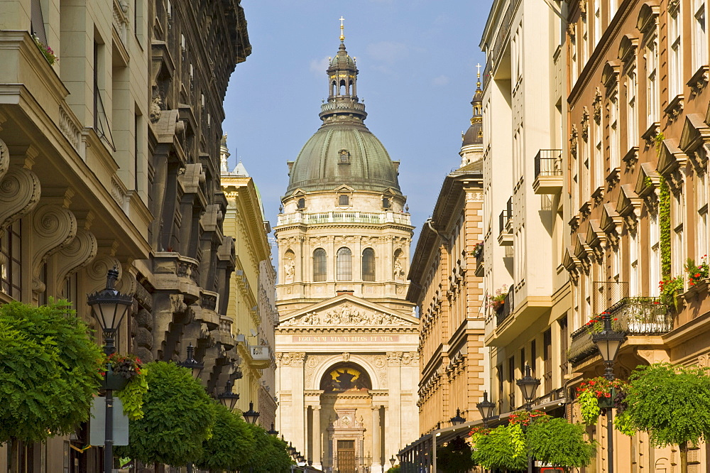 The neo-renaissance dome of St. Stephen's Basilica, shops and buildings of the Zrinyi Utca, central Budapest, Hungary, Europe