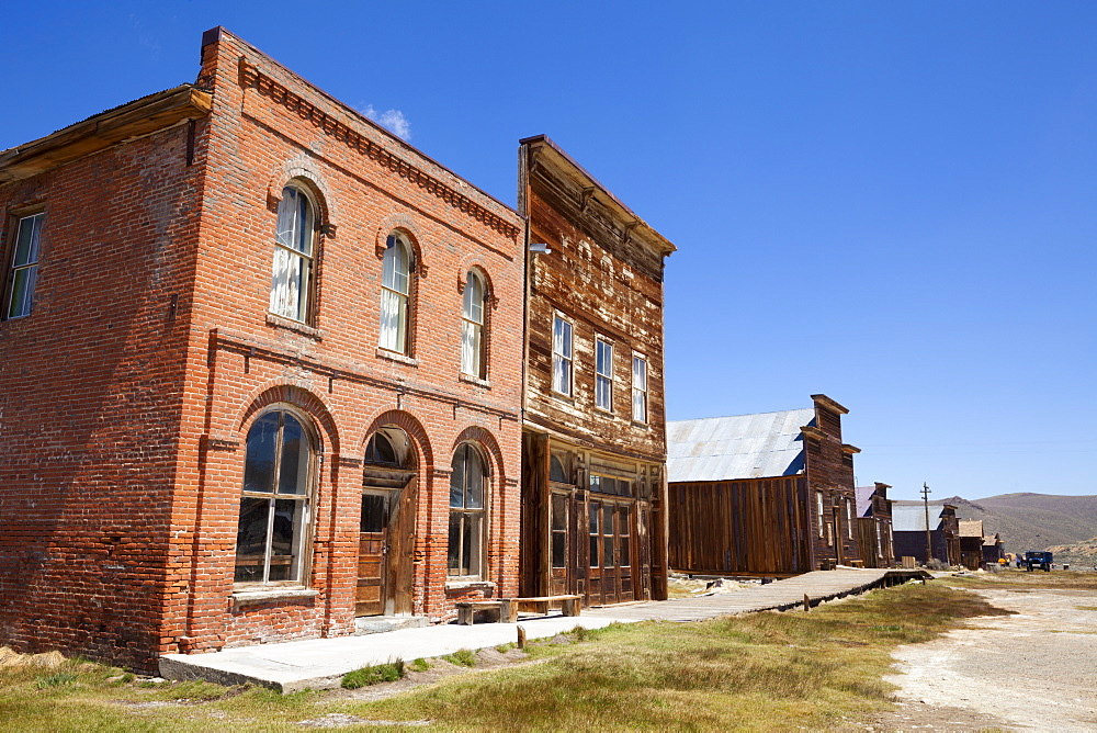 Brick Post Office and Dechambeau hotel, next to the wooden IOOF or Bodie Odd Fellows Lodge, a masonic lodge dating from 1878, on Main Street in the gold mining ghost town of Bodie, Bodie State Historic Park, Bridgeport, California, United States of America, North America