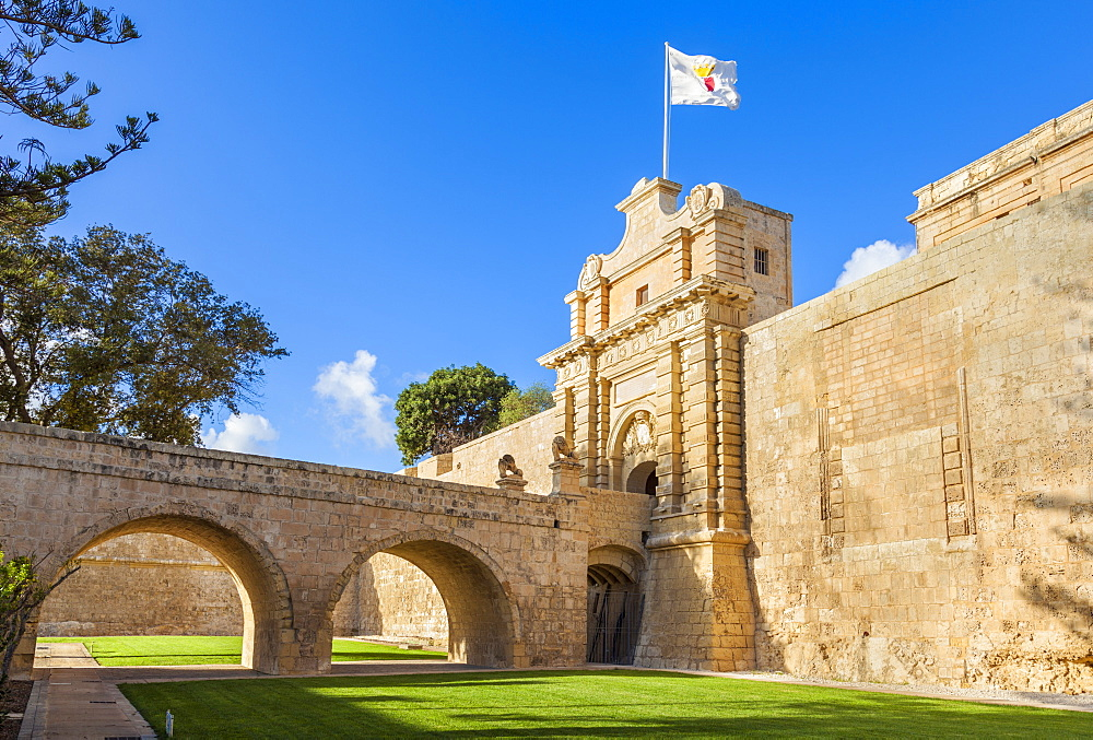 The Main gate with moat, garden and ramparts, Mdina, a Medieval walled city, Mdina, Malta, Europe