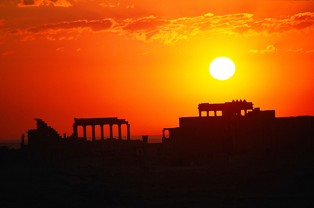 Syria, Palmyra Oasis, The Temple Consecrated In Year 32 To God Bel Seen In Silhouette At Sunrise