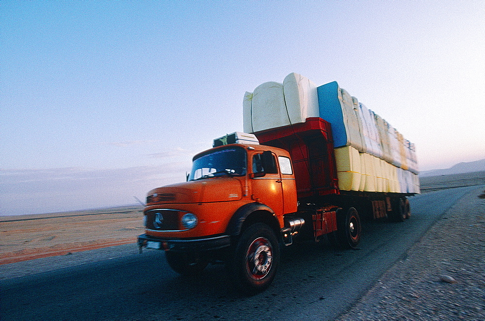 Syria, The East Desert Or Steppe, On The Road Damascus To Baghdad A Truck Overloaded With Plastic Foam