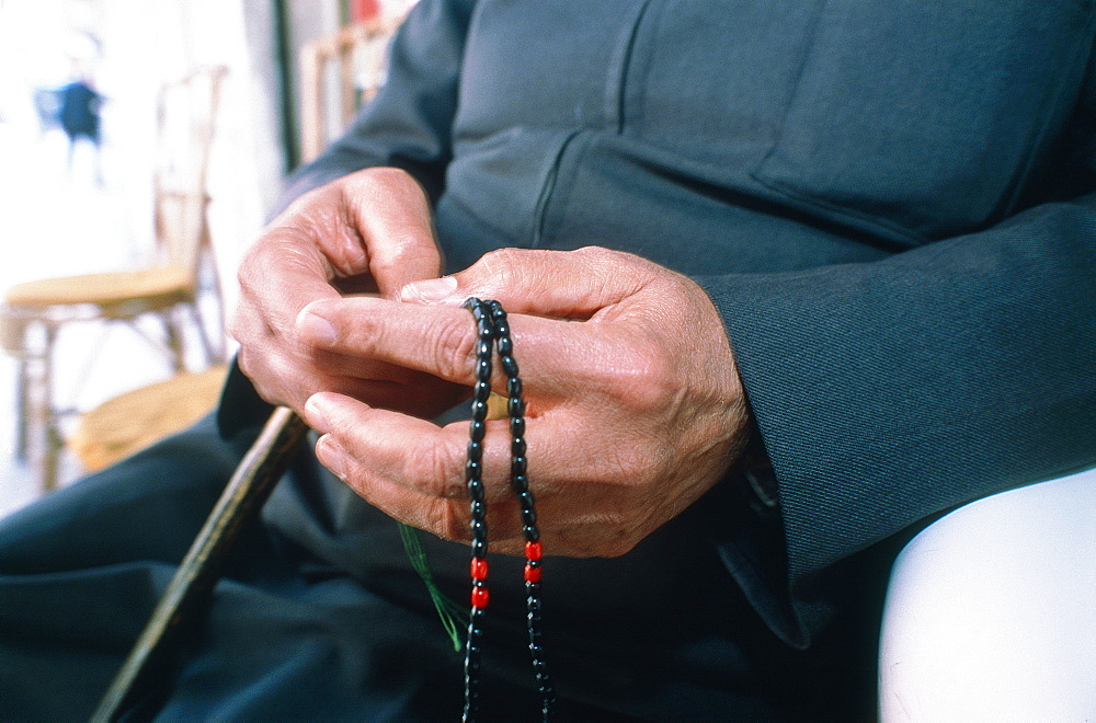 Syria, Coastline, Priest Holding A Stick And An Islamic Rosary Sbih To Help Repeat Prayers, Closeup