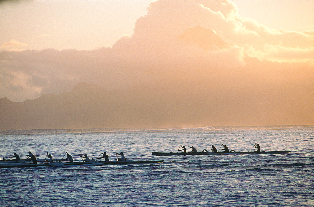 French Polynesia, Windward Islands, Tahiti, Outriggers Passing By At Dusk, Moorea Lagoon At Back