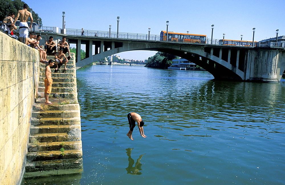 Spain, Andaloucia, Sevilla, Cruise On The Guadalquivir River, Boys Diving At The Telmo Bridge
