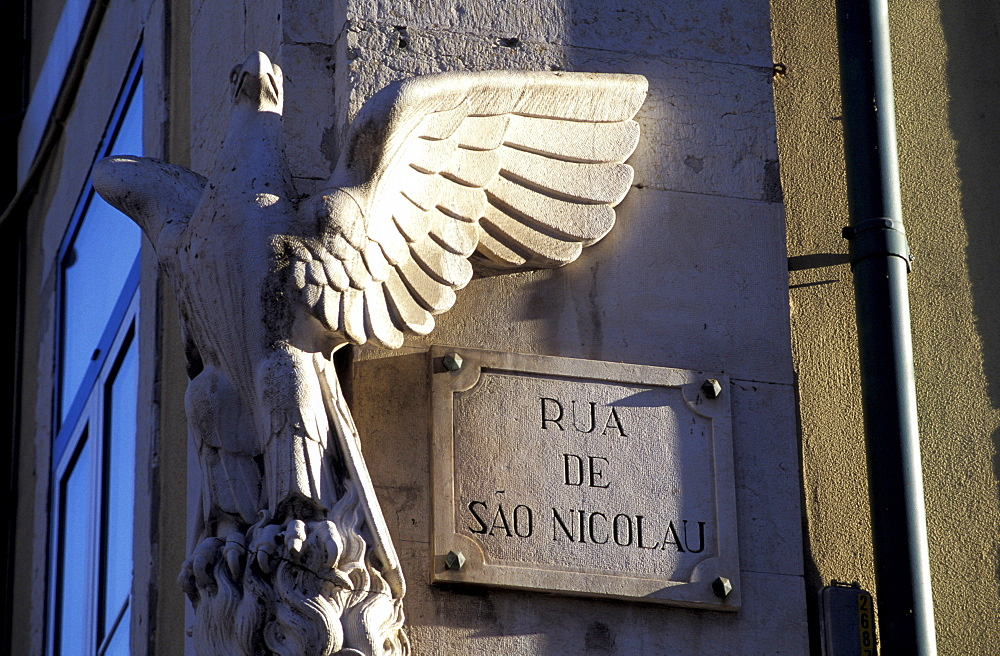 Portugal, Lisbon, Alfama Quarter, Road Sign And Carved Eagle At A Wall Corner