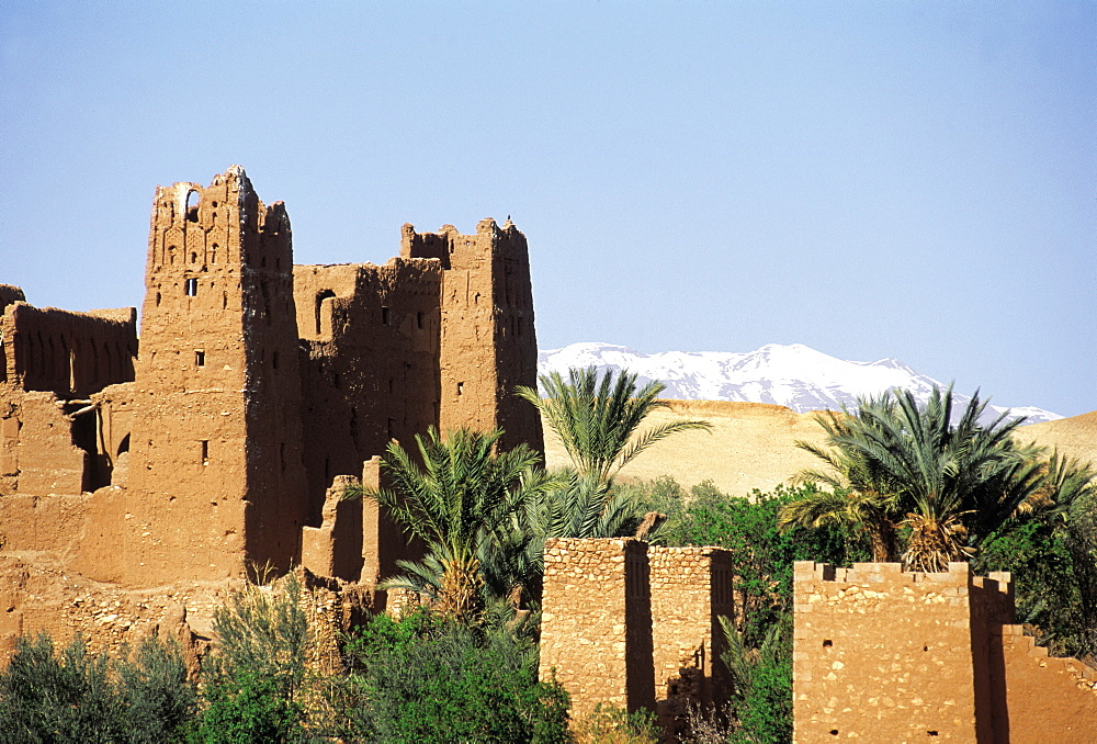 Morocco, Ouarzazate Region, Ait Ben Haddou Kasbah (Mud Fortress) At Spring, Atlas Mountains Capped With Snow Behind