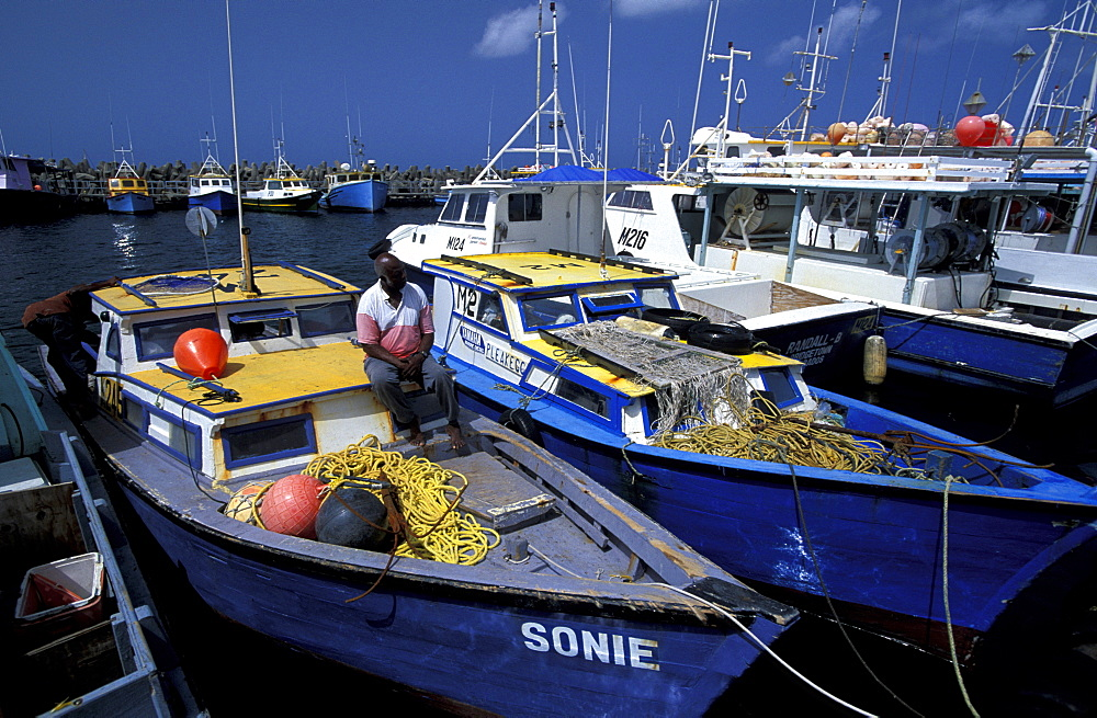 Caribbean, West Indies, Barbados, Bridgetown, Fishermen Harbour, Mr Funmaker Fisherman On His Boats Deck