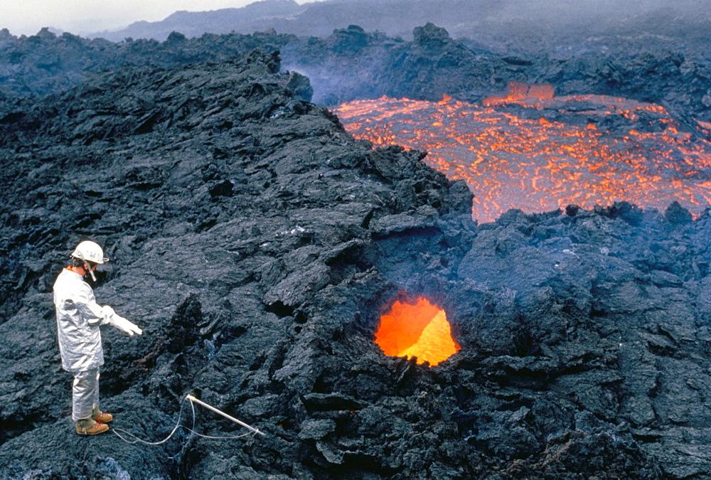 Vulcanologist at work, La Fournaise volcano, island of Reunion, Africa
