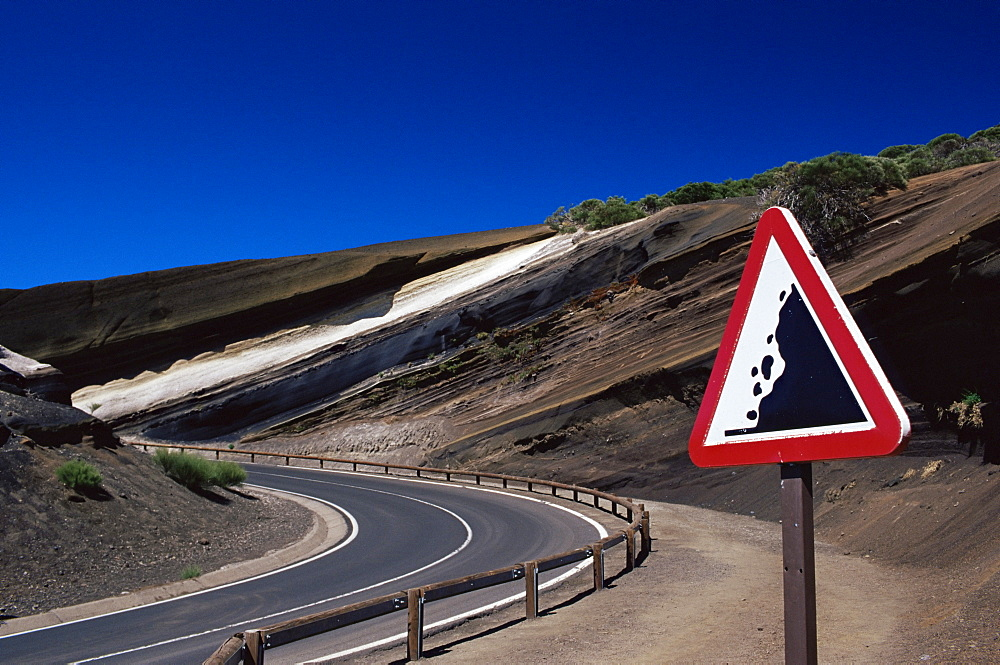Sign on road with stratified volcanic rocks in the background, Parque Nacional del Teide, Tenerife, Canary Islands, Spain, Atlantic, Europe