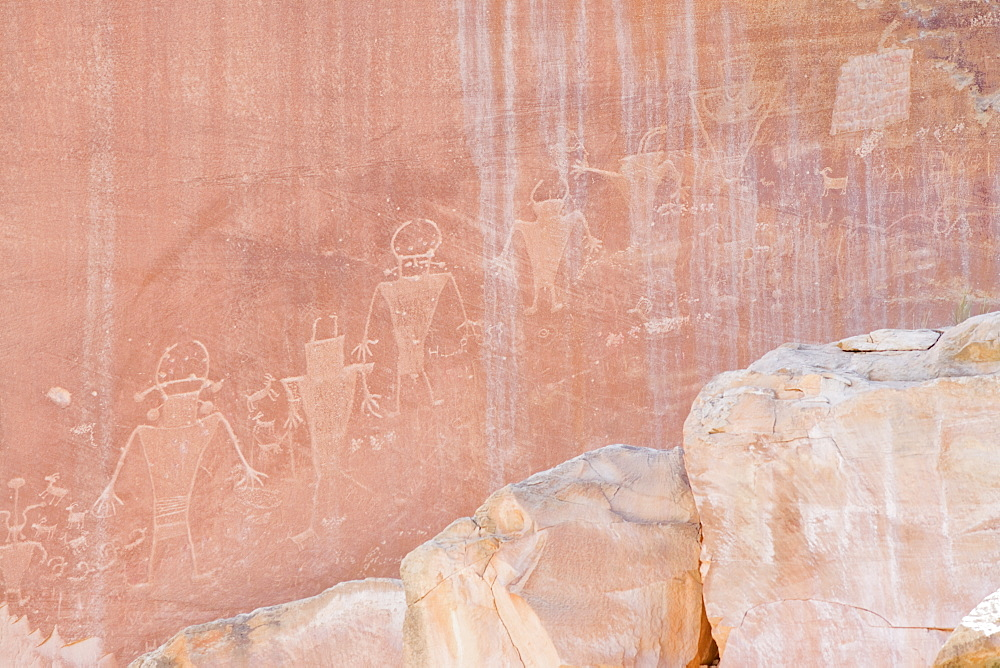 Ancient petroglyphs from the Fremont people on canyon wall, Capitol Reef National Park, Utah, United States of America, North America