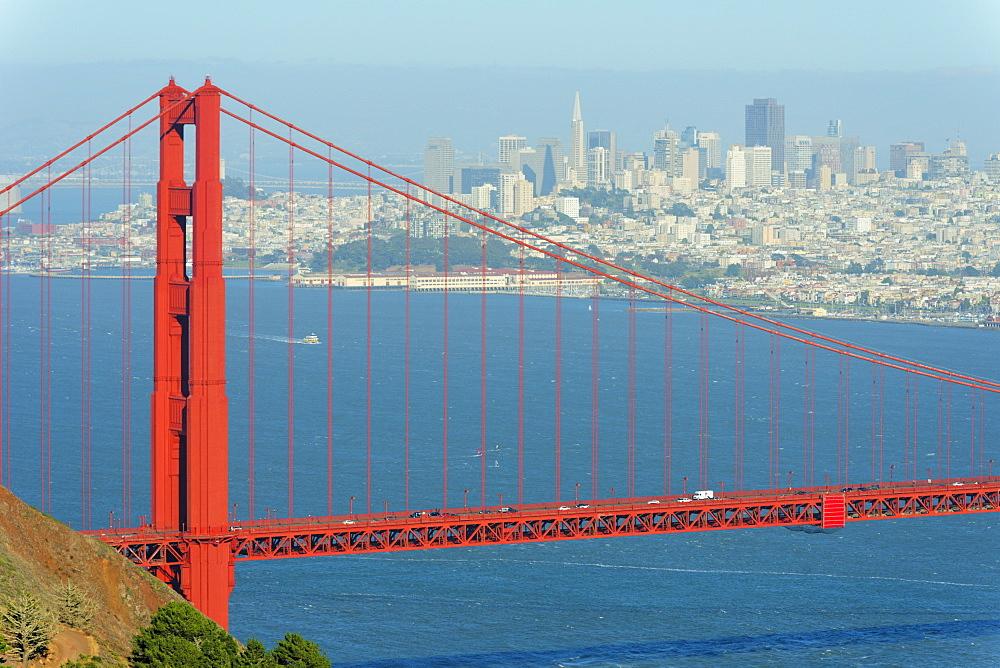 Golden Gate Bridge with San Francisco skyline in background, California, United States of America, North America