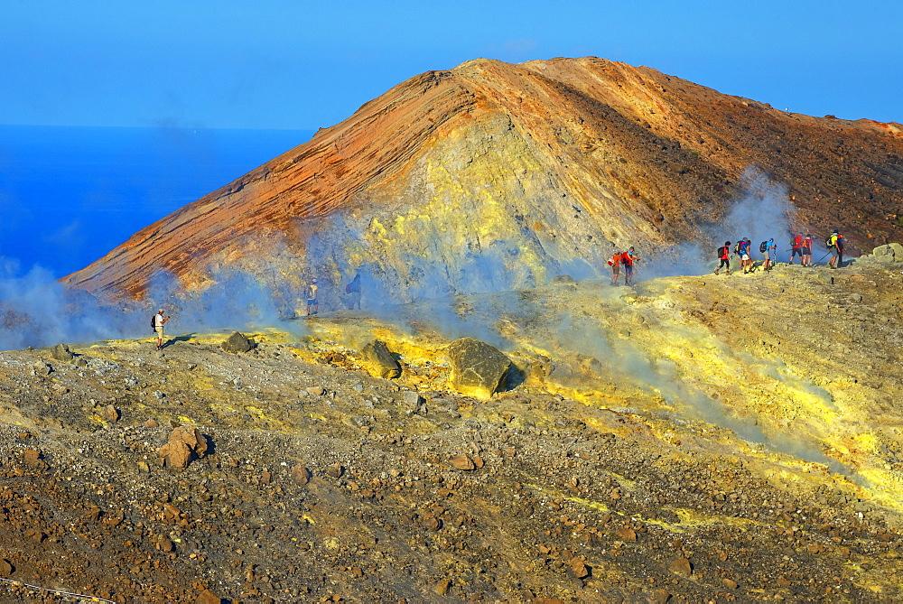 People walking through fumaroles on Volcano Gran crater rim, Vulcano Island, Aeolian Islands, UNESCO World Heritage Site, north of Sicily, Italy, Mediterranean, Europe