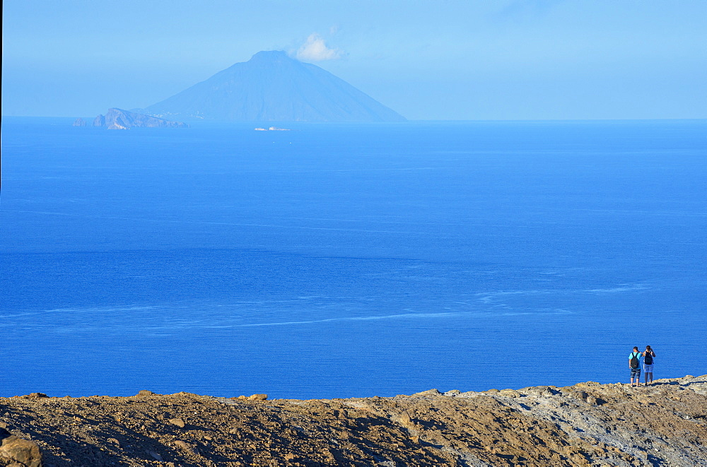 People looking at view of Stromboli island from Gran crater rim, Vulcano Island, Aeolian Islands, UNESCO World Heritage Site, Sicily, Italy, Mediterranean, Europe