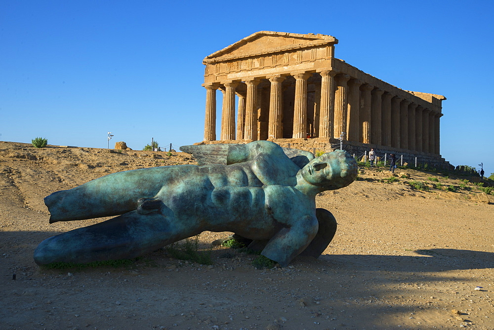 Modern sculpture of Icarus in front of the Temple of Concordia, Valley of the Temples, Agrigento, UNESCO World Heritage Site, Sicily, Italy, Europe