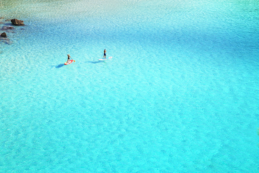 People paddleboarding on the emerald waters of Cala Mitjana, Menorca, Balearic Islands, Spain, Mediterranean, Europe - 718-2247