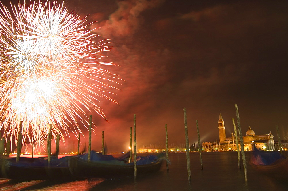Carnival fireworks, gondolas on waterfront at night, San Giorgio Maggiore, Venice, UNESCO World Heritage Site, Veneto, Italy, Europe - 733-1307