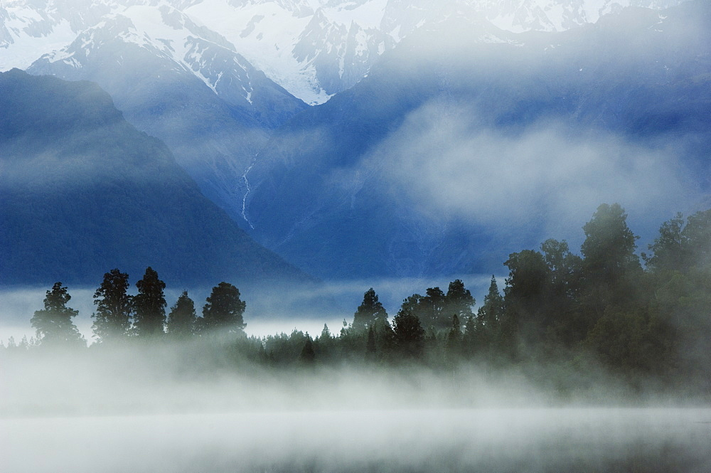 Lake Matheson in early morning mist, South Island, New Zealand, Pacific