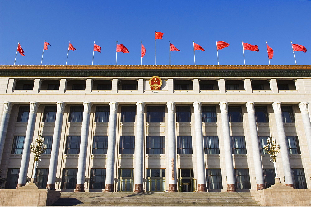 Chinese national flags on a government building Tiananmen Square Beijing China