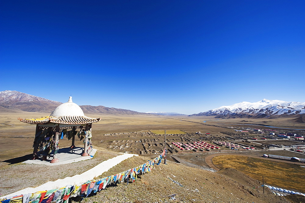 Prayer flags and sacred site overlooking the town of Bayanbulak, Xinjiang Province, China, Asia