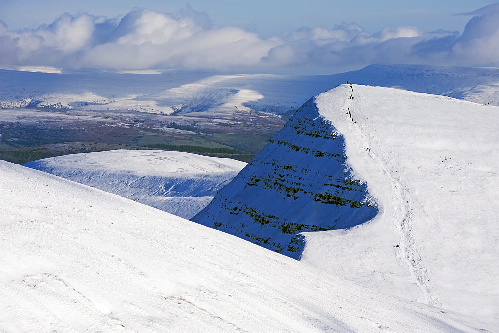 Hikers on snow covered Pen y Fan mountain, Brecon Beacons National Park, Powys, South Wales, United Kingdom, Europe