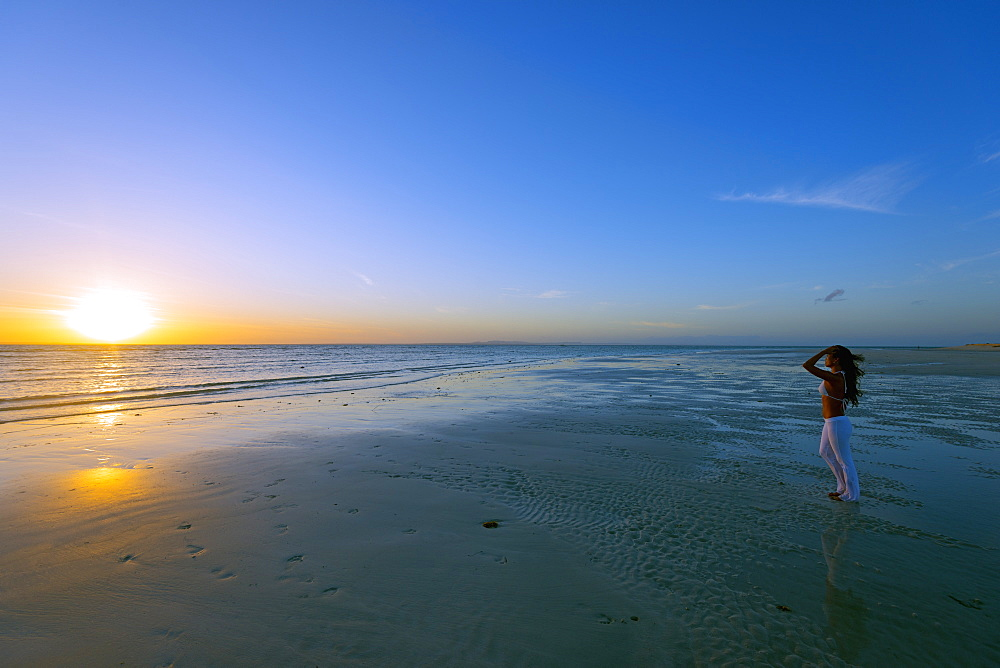 Girl on Sugar Beach at sunrise, Bantayan Island, Cebu, The Visayas, Philippines, Southeast Asia, Asia