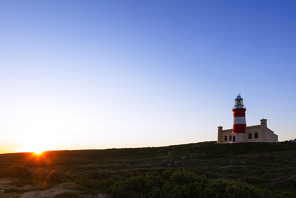 Agulhas lighthouse at southernmost tip of Africa at sunset, Agulhas National Park, Western Cape, South Africa, Africa