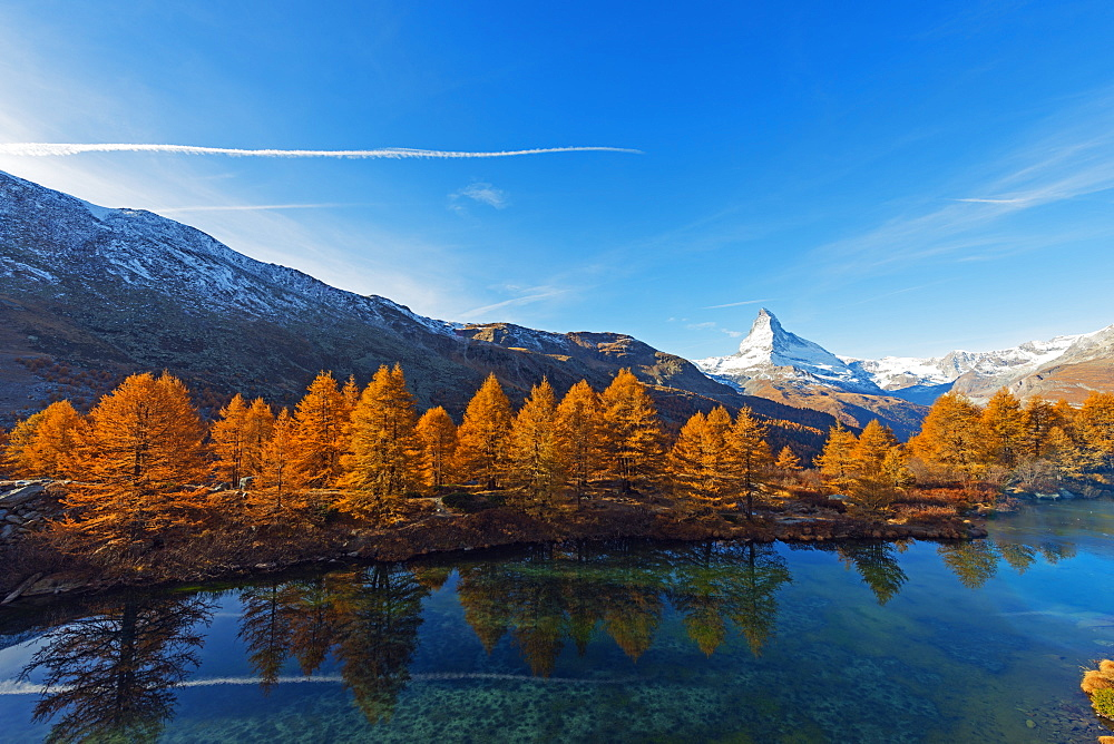 The Matterhorn, 4478m, and Grindjisee mountain lake in autumn, Zermatt, Valais, Swiss Alps, Switzerland, Europe