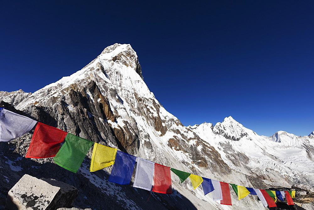 Asia, Nepal, Khumbu valley, Sagamartha National Park, Unesco World Heritage site, prayer flags on Ama Dablam (6812m)