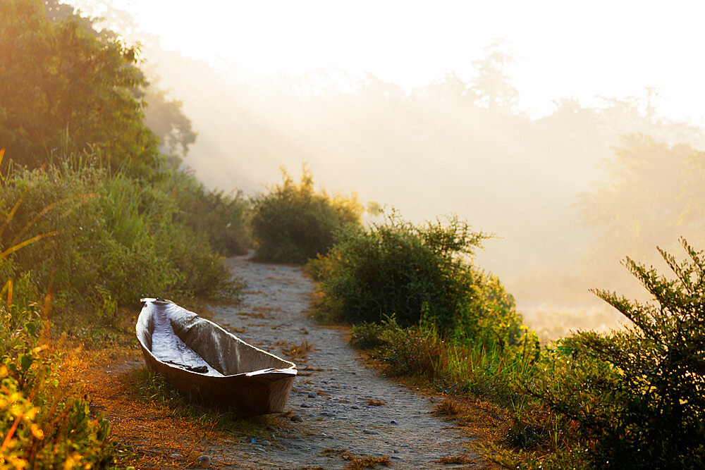 Canoe on a riverbank at dawn, Chitwan National Park, UNESCO World Heritage Site, Nepal, Asia
