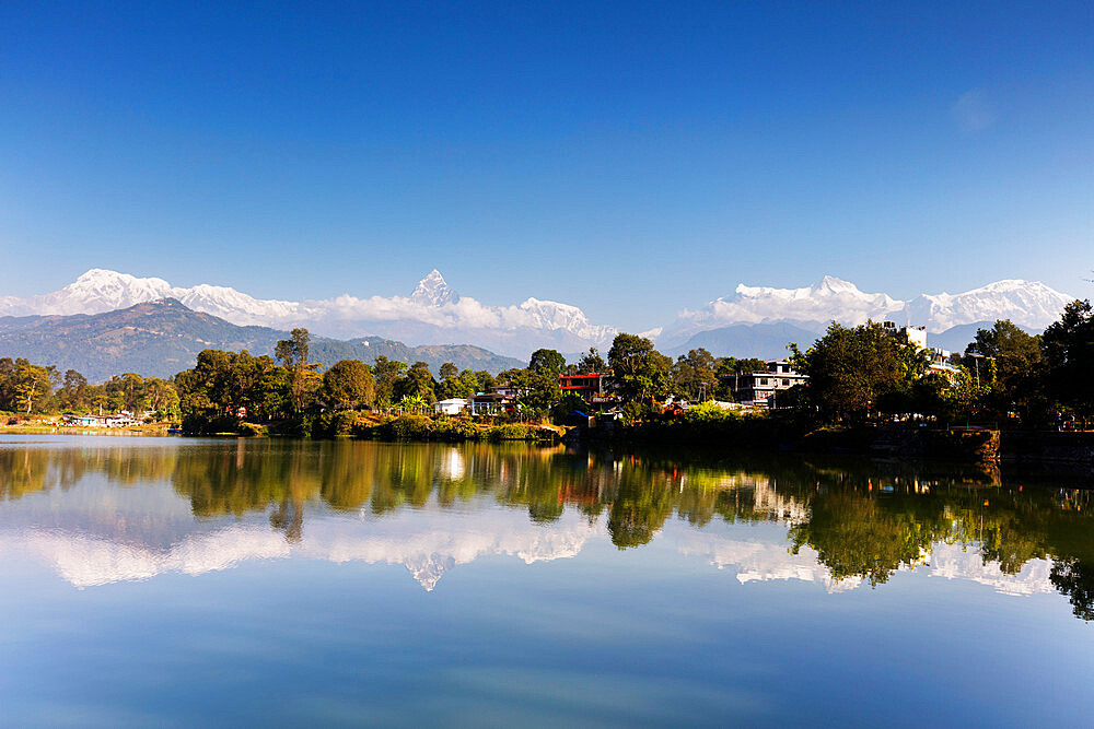 Asia, Nepal, Pokhara, reflection of Annapurna 8000m+ mountain range and Machapuchare (Fishtail mountain) 6993m