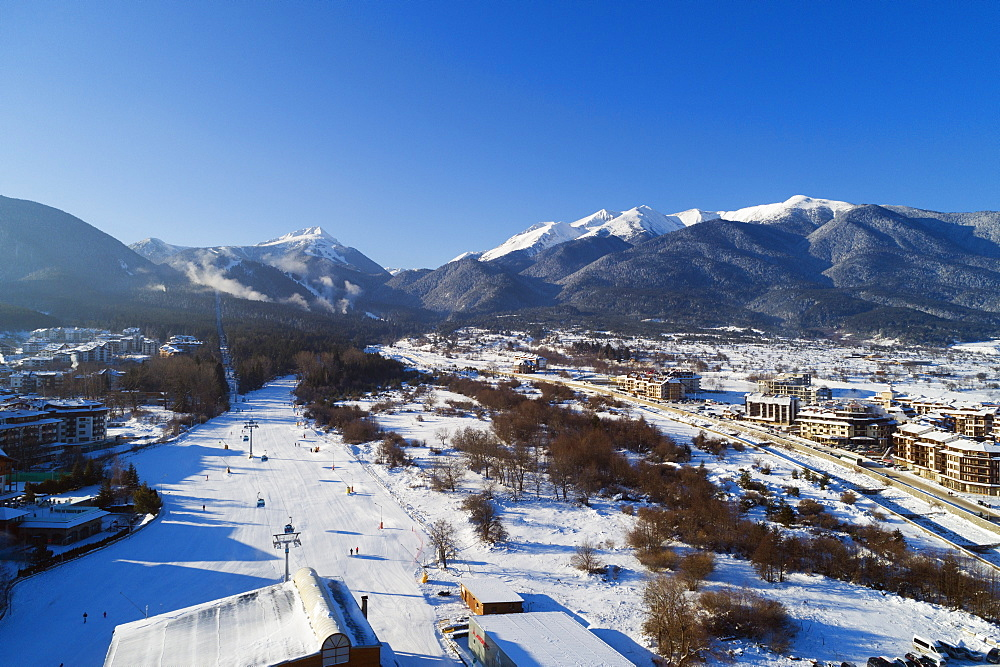 Europe, Bulgaria, Bansko, Pirin National Park, Unesco site, aerial view of home run winter ski slope - 733-8396
