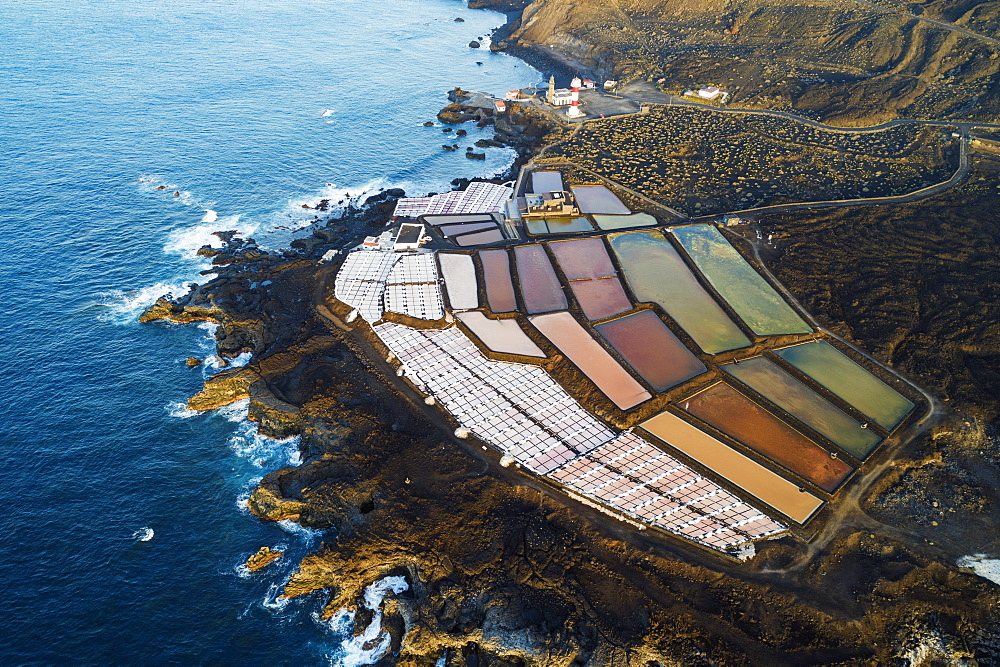 Europe, Spain, Canary Islands, La Palma, Unesco Biosphere site, aerial view of the salt pans and lighthouse at Faro de Fuencaliente - 733-8438