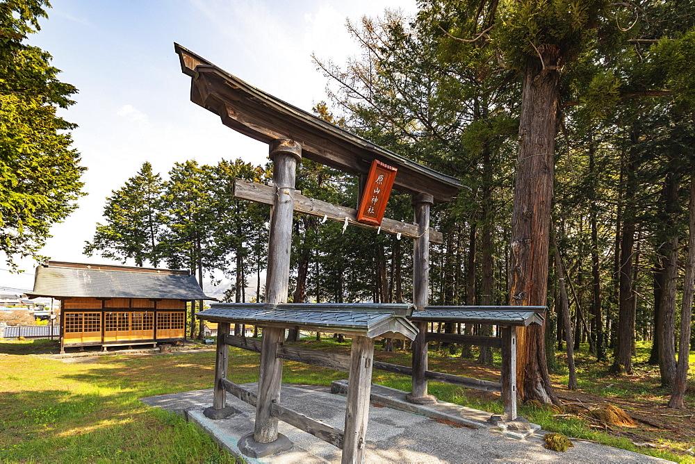 Asia, Japan, Honshu, Nagano prefecture, Harayama jinja shinto shrine, wooden torii gate with roofed beams