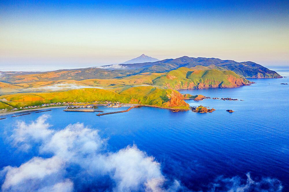 Japan, Hokkaido, Rebun island and Rishiri island in distance, coastal landscape